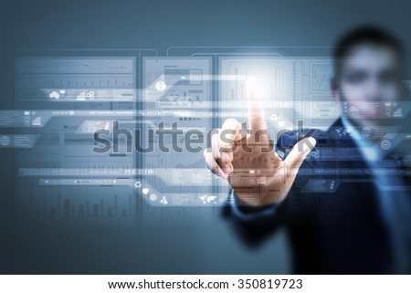 Businessman pushing with finger icon on virtual screen  - stock photo