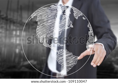 Businessman pushing World Map Globe line on the whiteboard. - stock photo