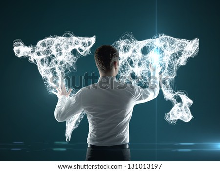 businessman pushing world map interface - stock photo