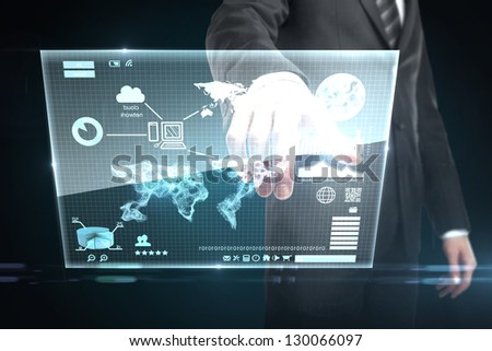 businessman pushing world map on interface screen - stock photo
