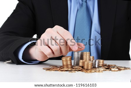 Businessman put coins isolated on white - stock photo