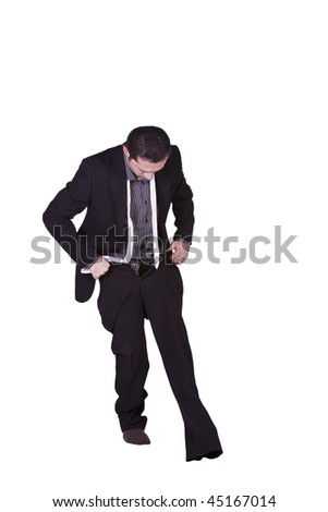 Businessman Putting His Pants On Getting Ready - Isolated Background - stock photo