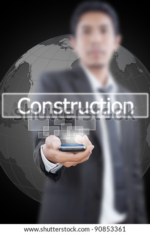 Businessman putting mobile with Construction word. - stock photo