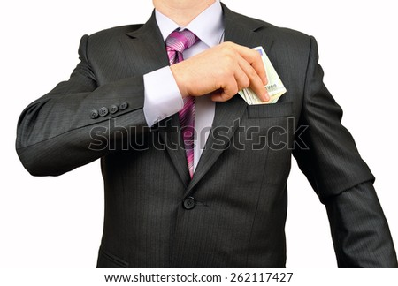 Businessman putting money in pocket - stock photo