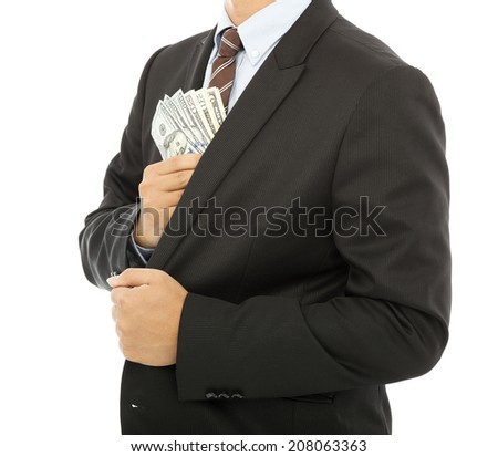 businessman putting money in the pocket with white background - stock photo