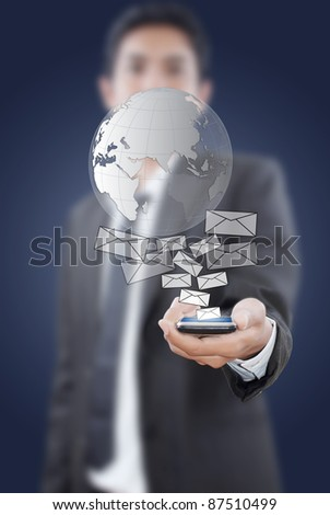 Businessman putting touch screen mobile phone with mail globe. - stock photo