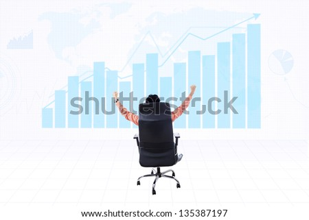 Businessman raising his arms with profit bar chart background - stock photo