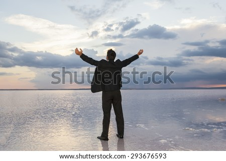 Businessman Raising His Hands or Open arms when sun rising up - stock photo