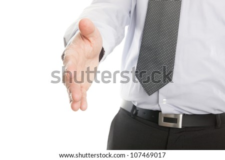 Businessman reaching out to shake hands isolated on a white background - stock photo