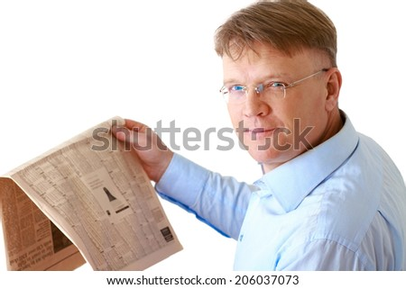 Businessman reading a newspaper , isolated on background - stock photo