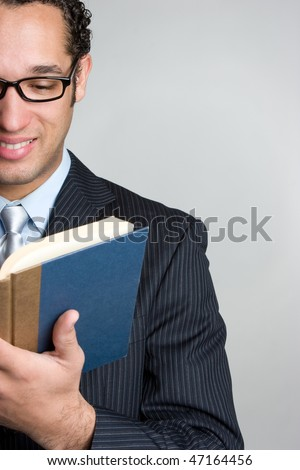 Businessman Reading Book - stock photo