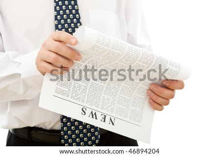 Businessman reading news from paper - isolated closeup - stock photo