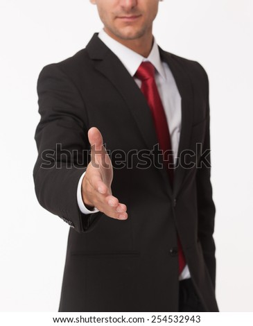 Businessman ready for handshake isolated on white - stock photo