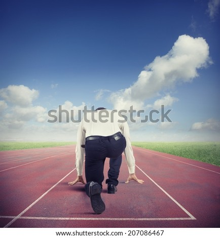 Businessman ready to start for the business competition - stock photo