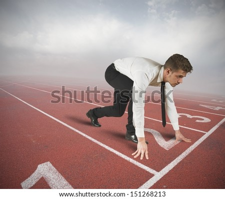 Businessman ready to start the competition - stock photo