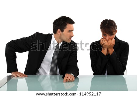 Businessman reassuring scared colleague - stock photo