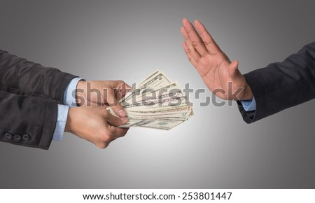 Businessman refusing the money offered by businessman on white background, no corruption - stock photo