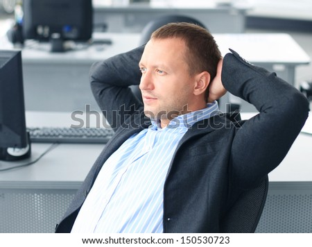 businessman relaxing in a modern office - stock photo