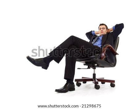 Businessman relaxing in armchair - isolated - stock photo