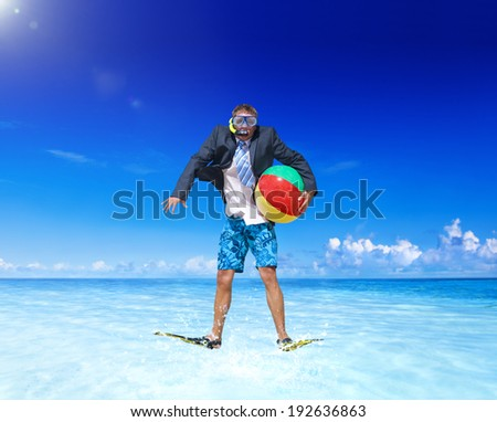 Businessman relaxing on a beach. - stock photo