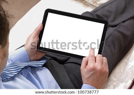Businessman relaxing whilst working on digital tablet with blank white screen for copy - stock photo