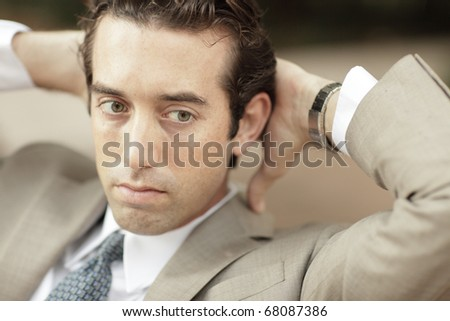 Businessman resting his head in his hands - stock photo