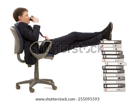 Businessman resting in armchair with legs up isolated on white background - stock photo