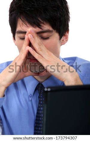 businessman resting in front of his computer - stock photo