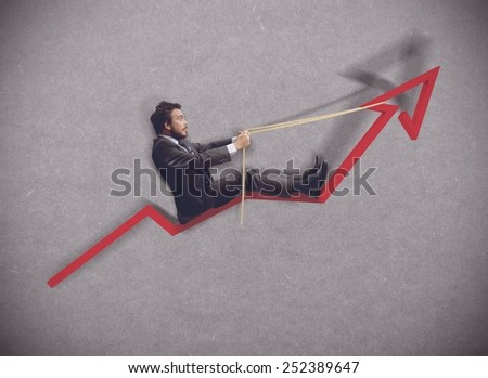 Businessman rides towards the increase of economy - stock photo