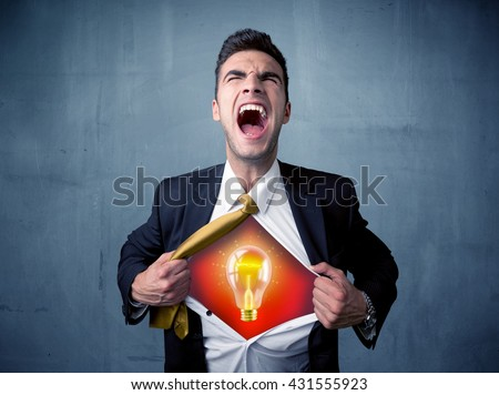 Businessman ripping off shirt and idea light bulb appears on his chest concept on background - stock photo