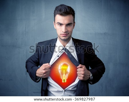 Businessman ripping off shirt and idea light bulb appears on his chest concept on backround - stock photo