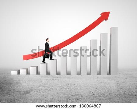 businessman rises up on business diagram - stock photo
