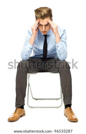 Businessman rubbing temples - stock photo