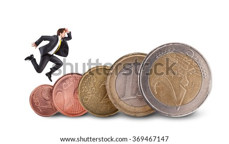 Businessman running on euro coins isolated on white background - stock photo