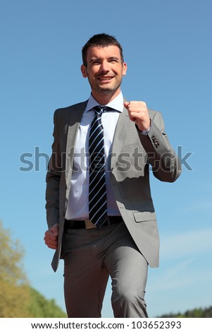 businessman running outdoor in summer - stock photo