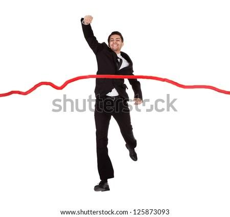 Businessman running through finishing line. Isolated on white - stock photo