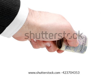Businessman's hand holding a stack of twenty pounds notes isolated on white background. - stock photo