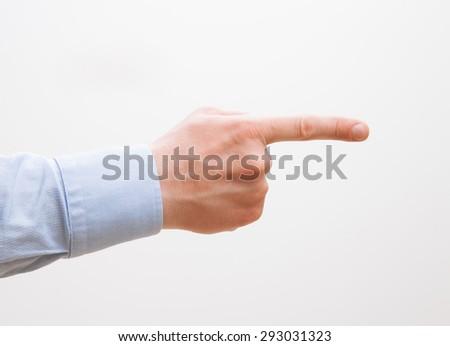 Businessman's hand indicating something, white background - stock photo