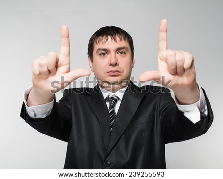 Businessman's hands making frame. - stock photo