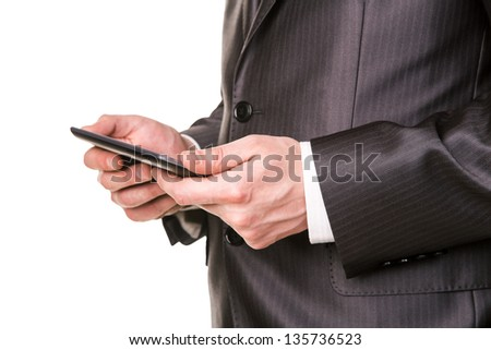 Businessman's hands working on a tablet pc comuter isolated on white - stock photo