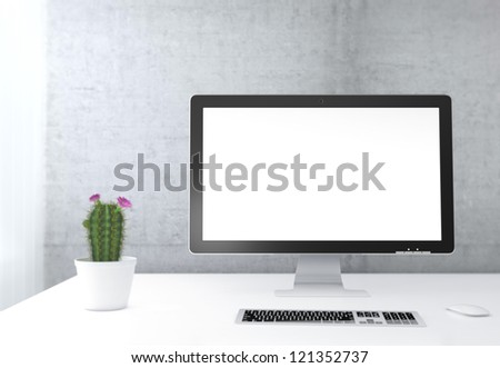 Businessman's place of work with with computer monitor, keyboard and cactus on white table next to concrete wall - stock photo