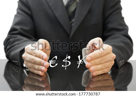 businessman's protecting investment in currency  - stock photo