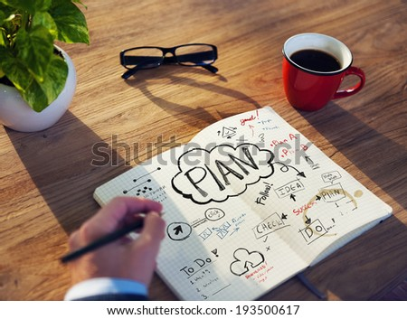 Businessman's table Planning Business Issue - stock photo