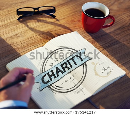 Businessman's table with Charity Concept - stock photo