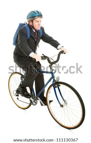 Businessman saving gas and money by riding his bicycle to work.  Full body isolated. - stock photo