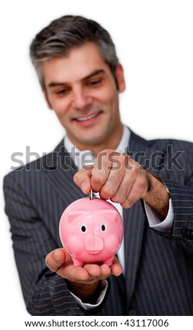 Businessman saving money in a piggybank against a white background - stock photo