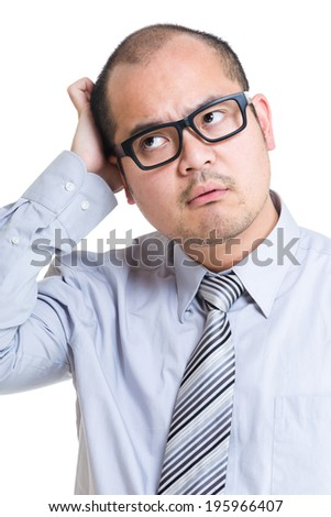 Businessman scratching head - stock photo