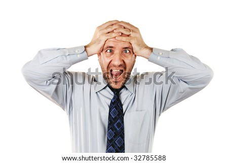 Businessman  screaming with hands on head, isolated over white - stock photo