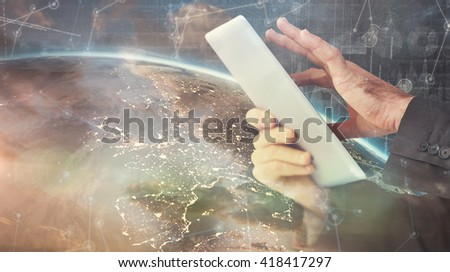 Businessman scrolling on his digital tablet against hologram background - stock photo
