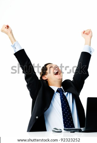 Businessman sealing his first deal and raises both arms in the air - stock photo